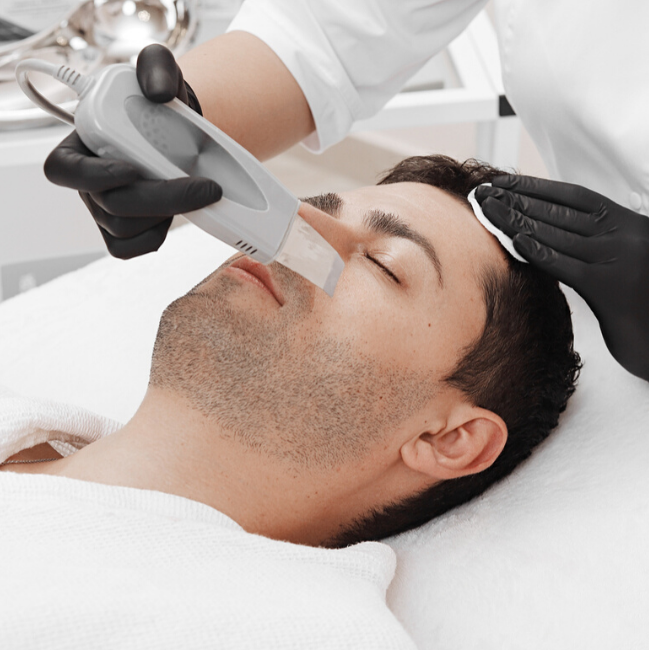 Man getting facial at Linde Esthetics